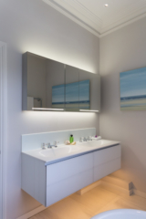Bathroom, task light at the mirror and soft wash of light under the vanity unit
