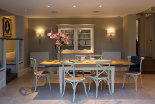 Dining area, LED downlights focusing pools of light on the table
