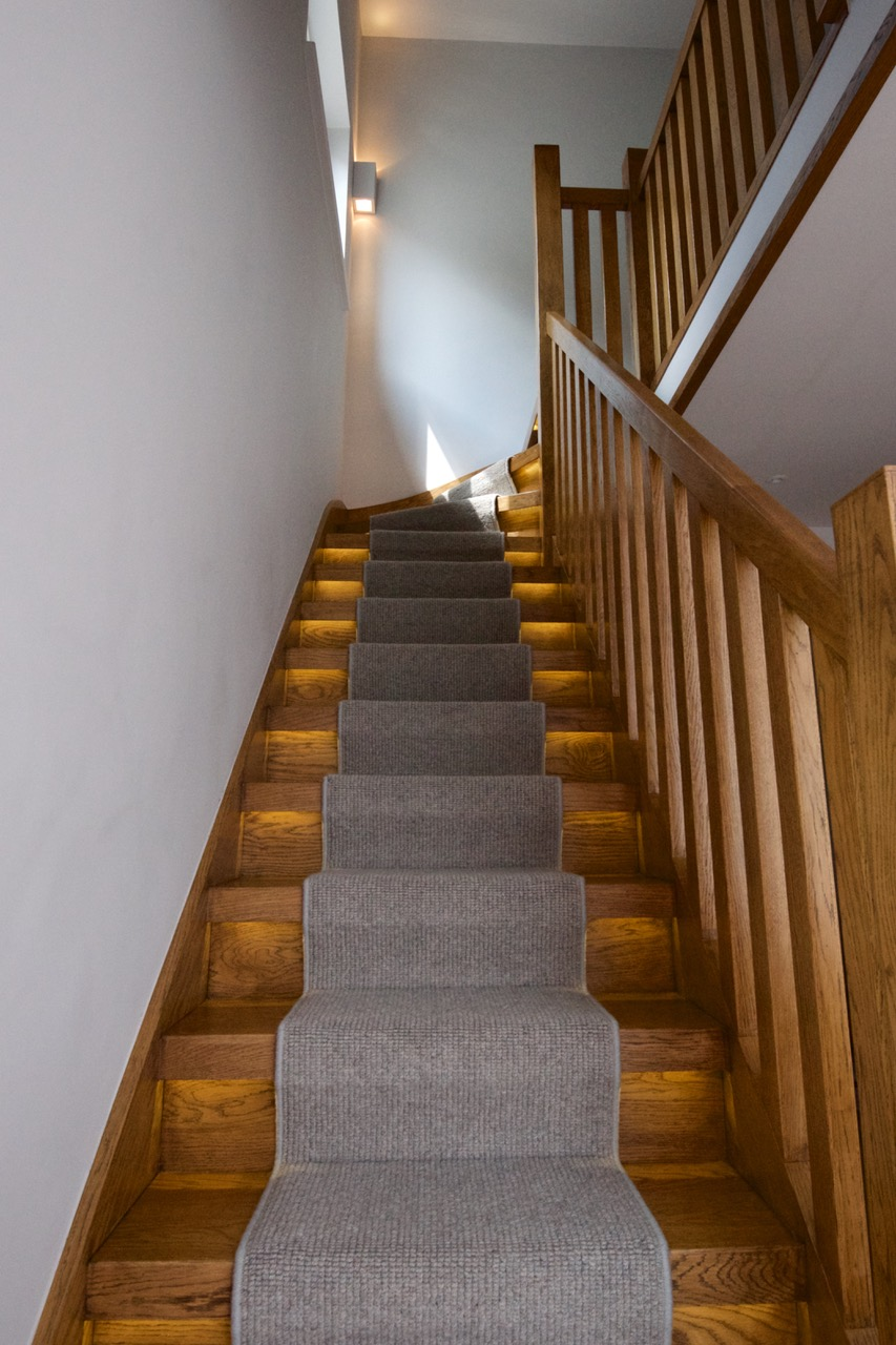 Staircase, LED striplights recessed on each side of the runner